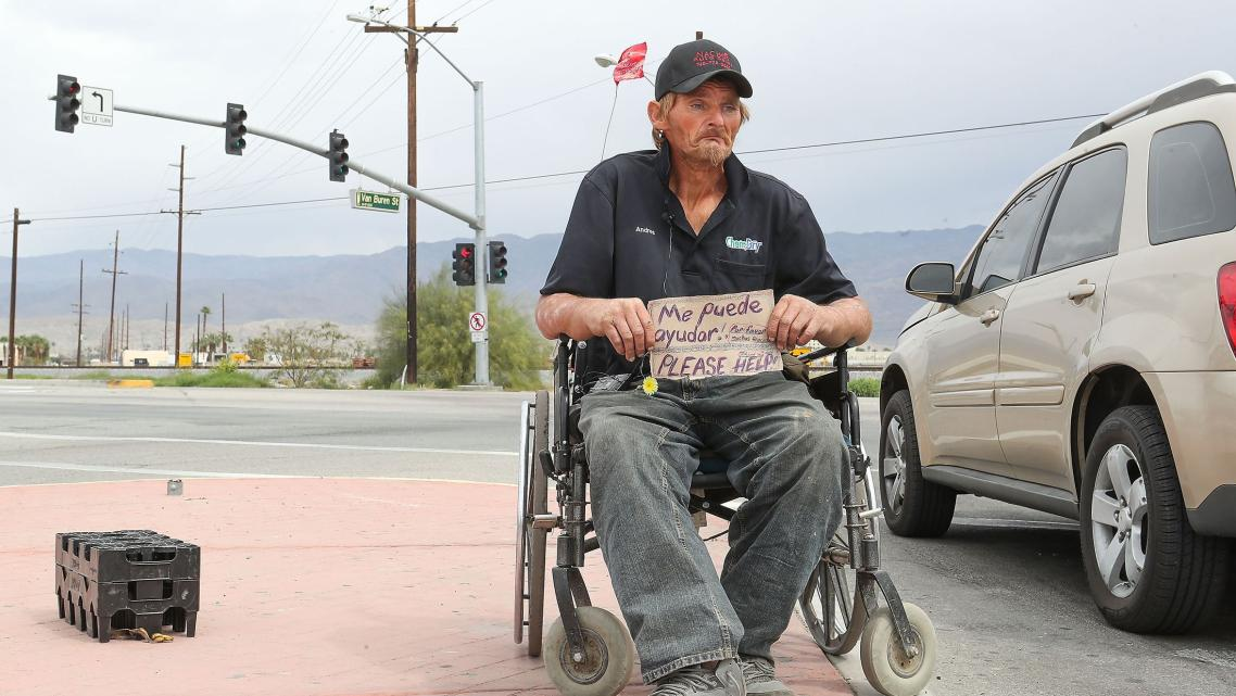 Robert Hensley panhandles for enough money to buy some heroin which treats his pain and his addiction in Indio, April 8, 2019.