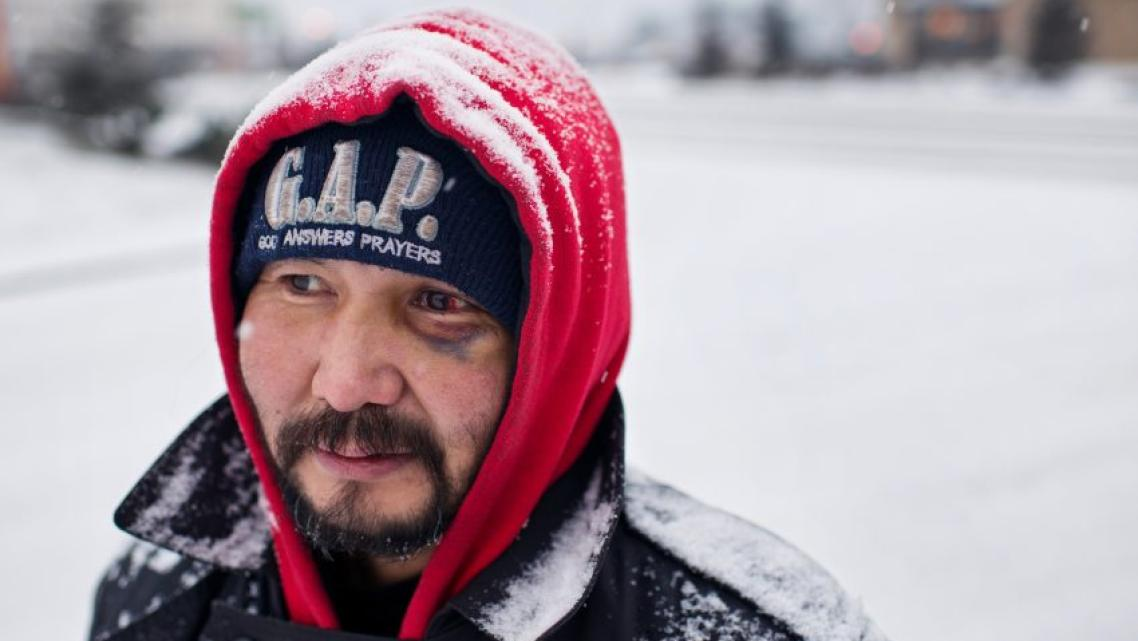 Marc Lester / ADN Albert Edwards panhandles at the entrance to Walmart on Benson Boulevard. He said he has been homeless for five years.