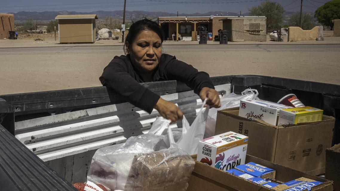 In New Mexico, Lynette Quintana loads up food from the USDA's Food Distribution Program on Indian Reservations.