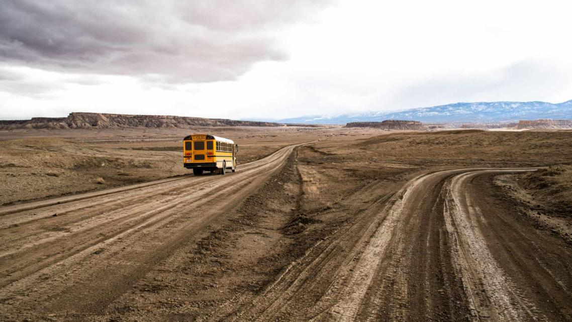 A school bus on the unpaved Indian service route 5010 near Sanostee. The seven-mile corridor connects as many as 2,500 resident