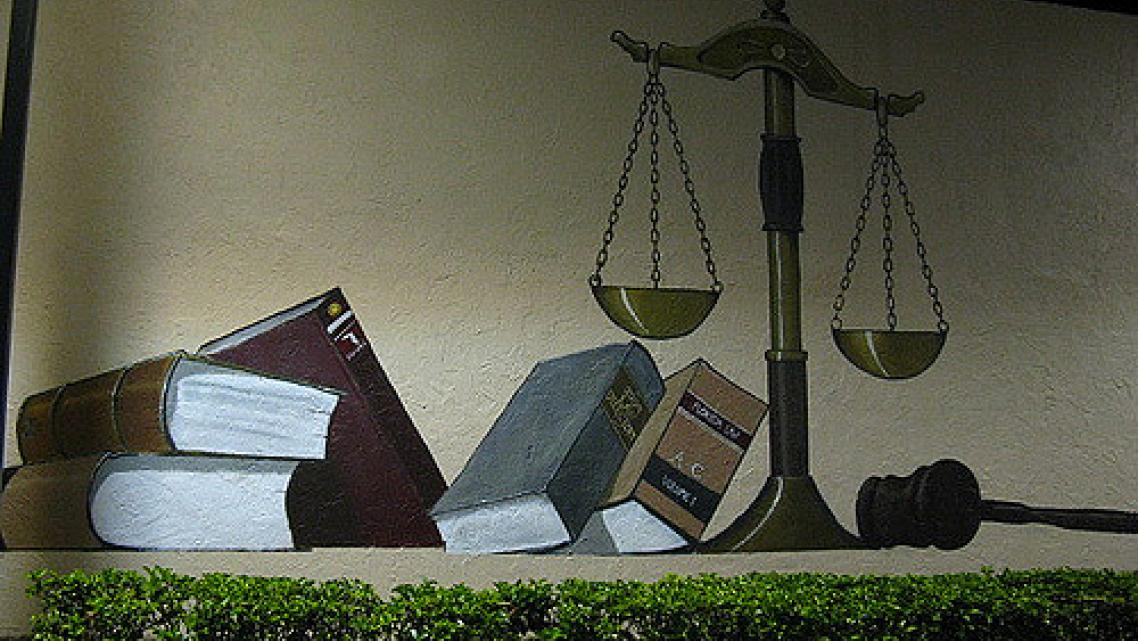 Photo by Flickr: Clyde Robinson: Scales of Justice