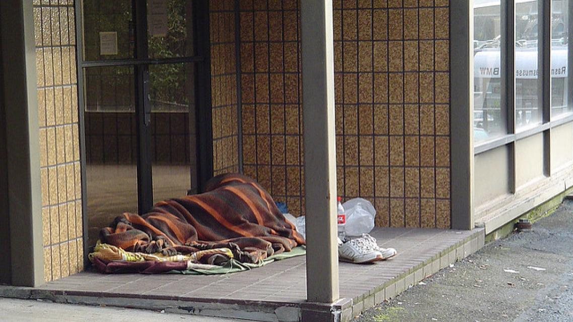 homeless individual sleeping outside