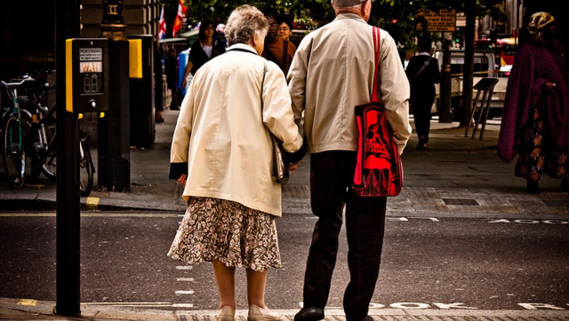 Elderly people crossing the street