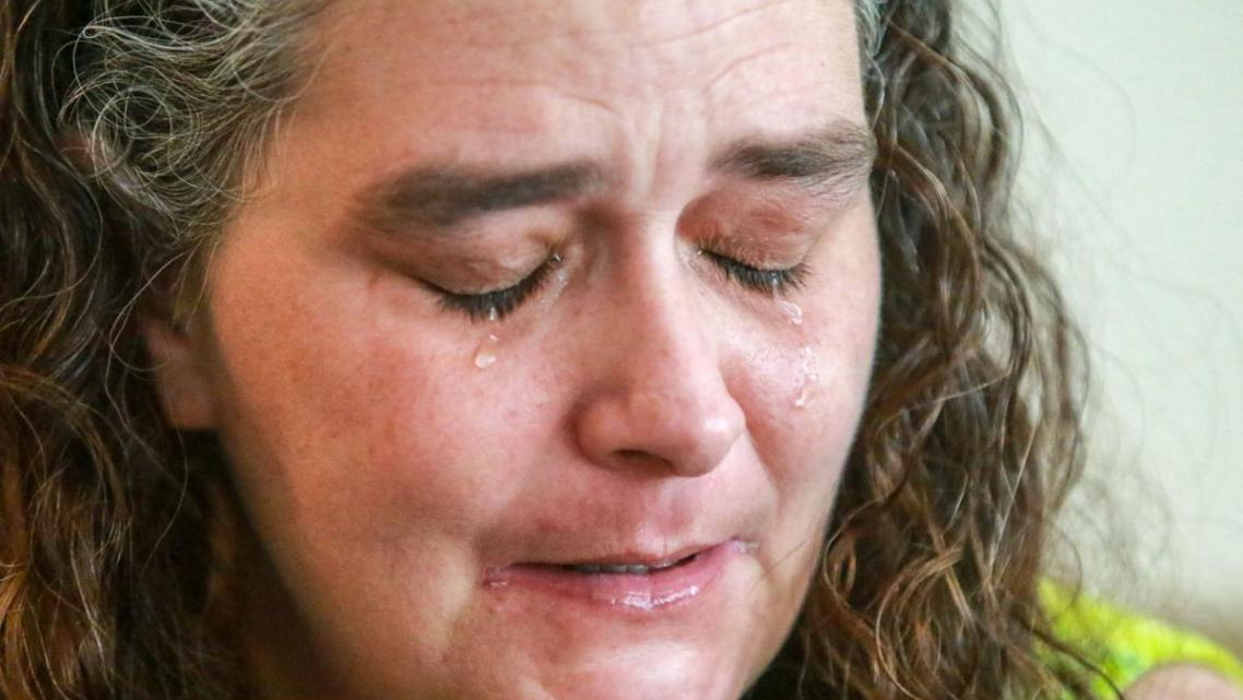 Tears flow as Adria Trader talks about how she lost her kids to the child welfare system.