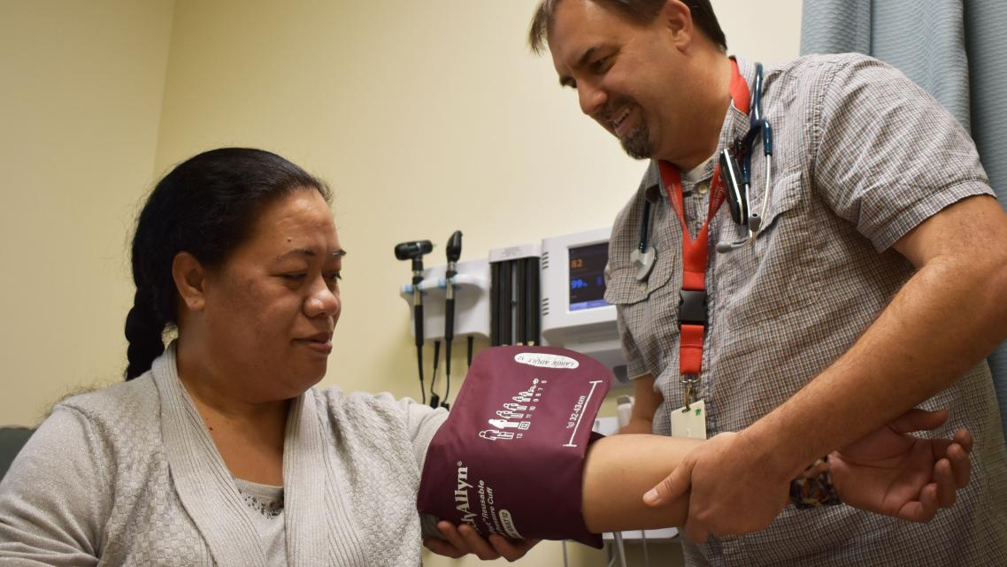 A patient at the Ravenswood Family Health Center in East Palo Alto has her blood pressure checked. In 2017, about 87 percent of