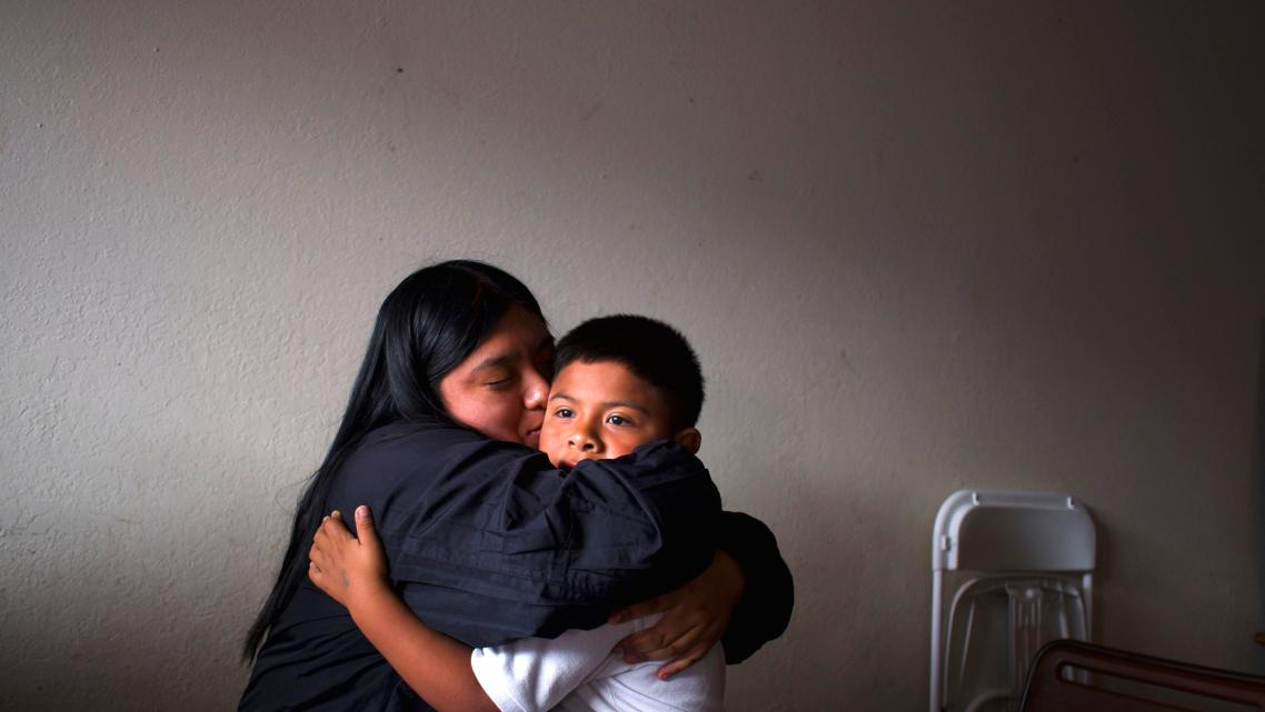 Resi Salvador, left, with her little brother, Hugo, in their small apartment on the north side of Salinas.