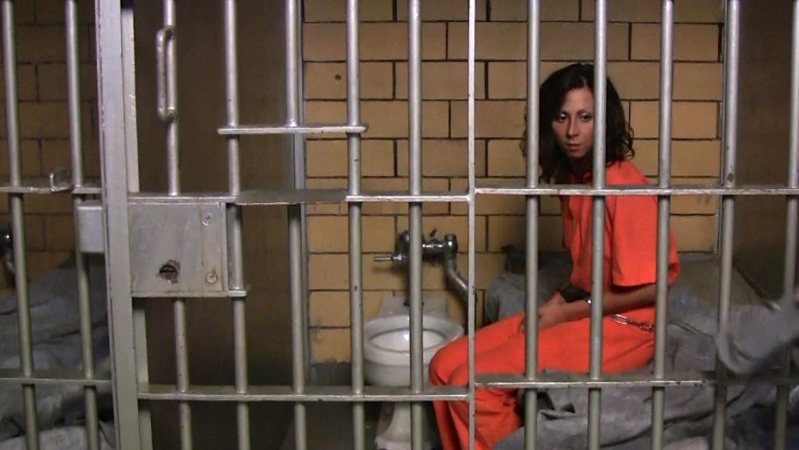 Female prisoner in cell