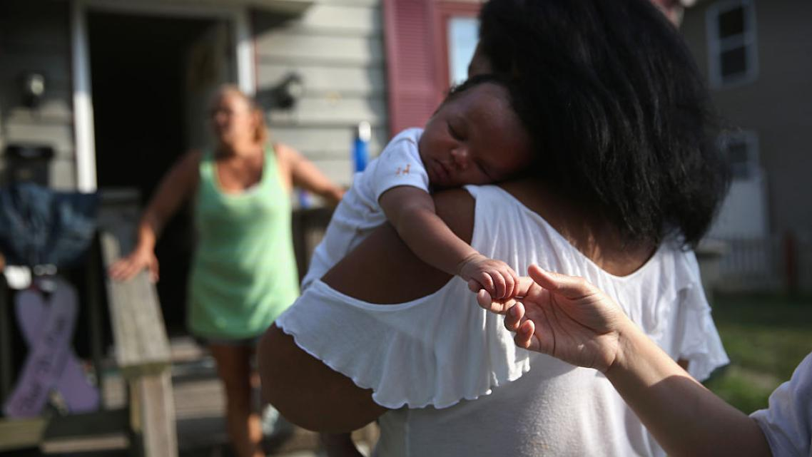 Grandmother Valencia Terrell arrives with her grandchild to stay temporarily at a friend's home on in Atlantic City. After her h