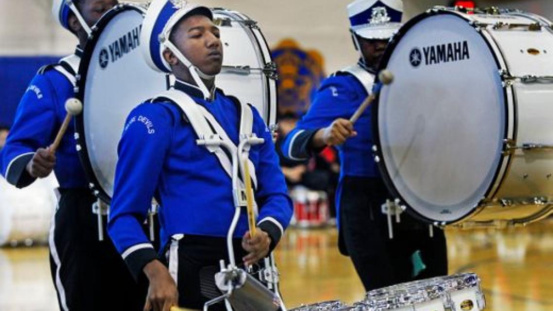 Maleak Taylor (left), a freshman at North Divison High School, plays quints for the drumline during the MPS Hosts City Drumlime