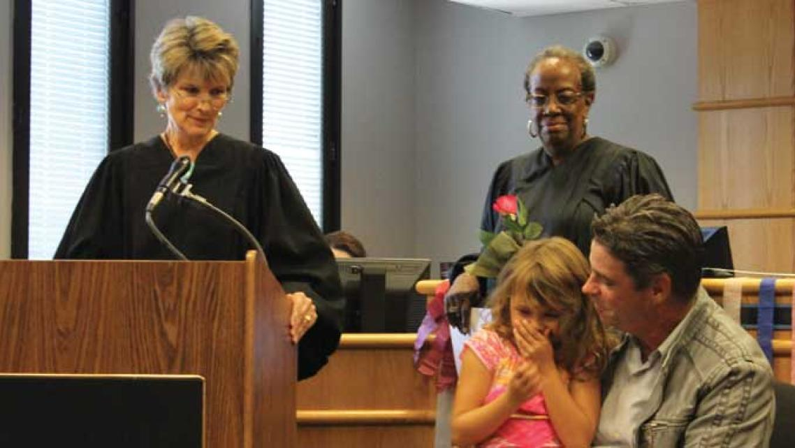 Judges Julia Garratt (far left) and Patricia Clark (center) at a family treatment court graduation in Seattle.