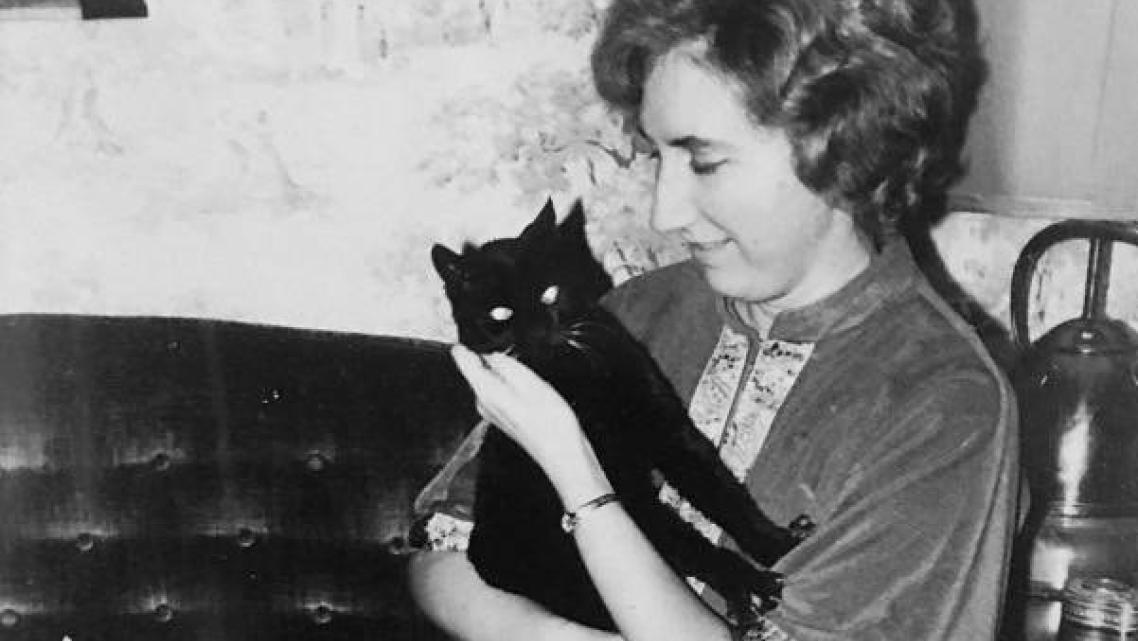 Colleen Loughman with one of her two cats, when she was a student in the 1950s at Holy Names University in Oakland. Loughman die