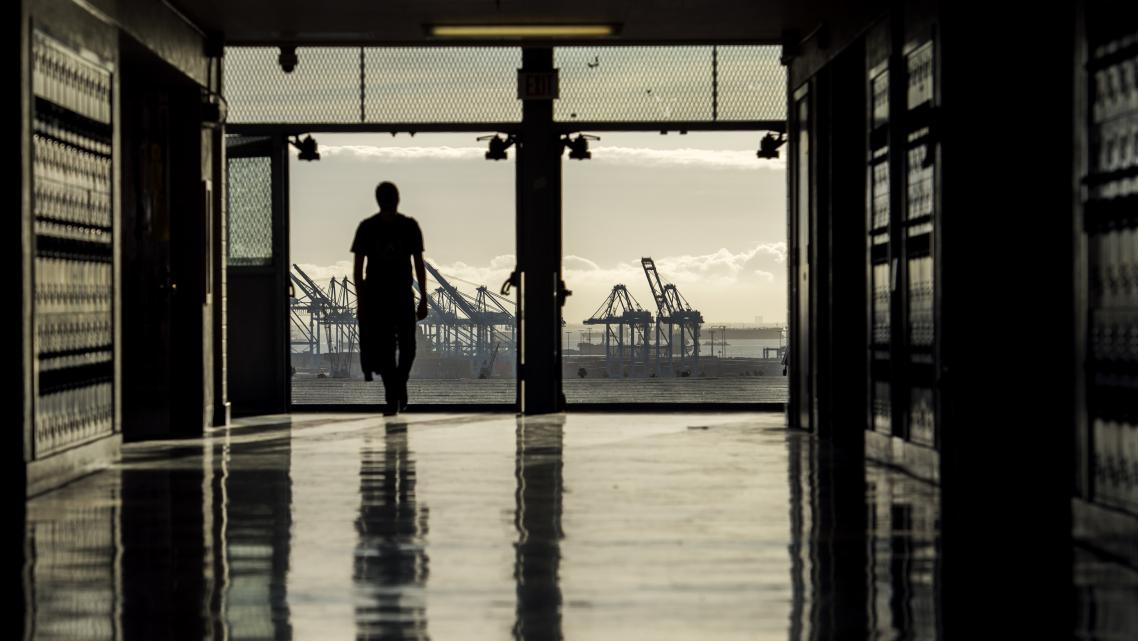 A student walks into one of the buildings at San Pedro High School that overlooks the Port of L.A. in San Pedro Wednesd