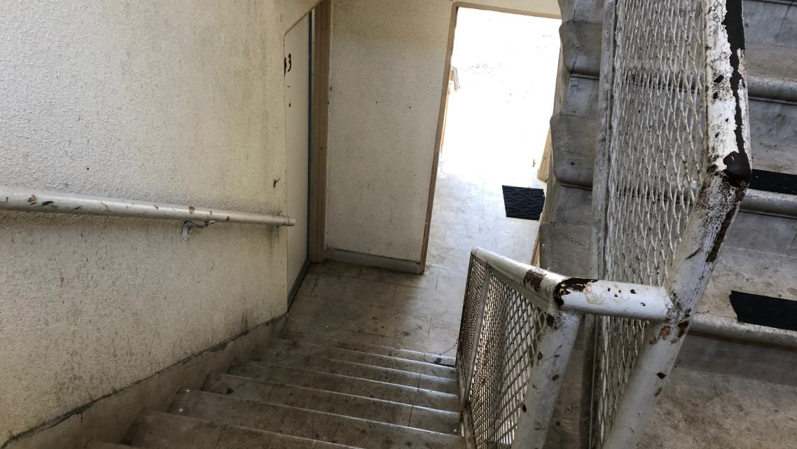 Why do low-wage workers in San Luis Obispo County live in crumbling apartments?