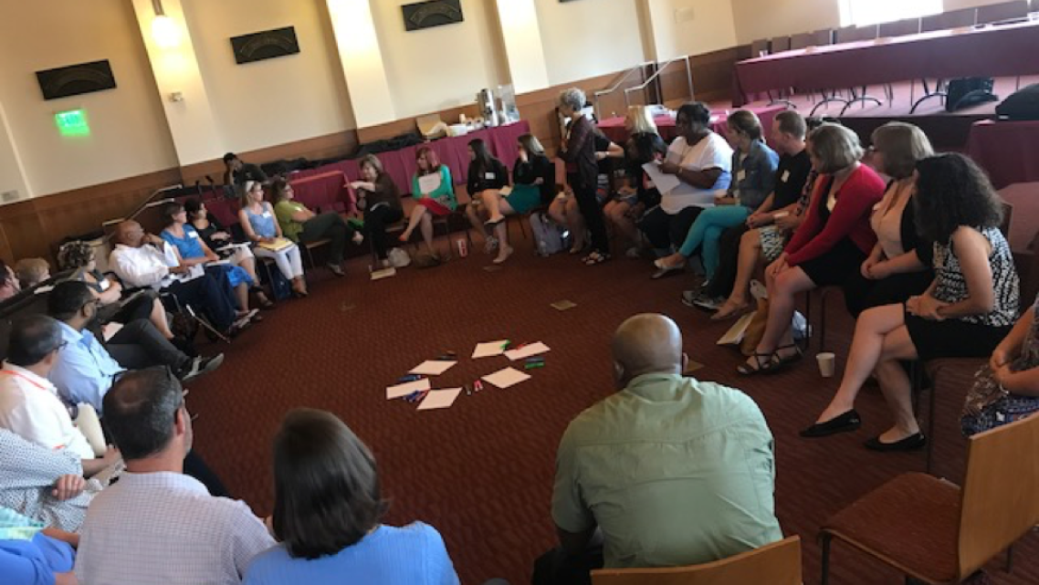 Fellows participate in group discussion in a circle