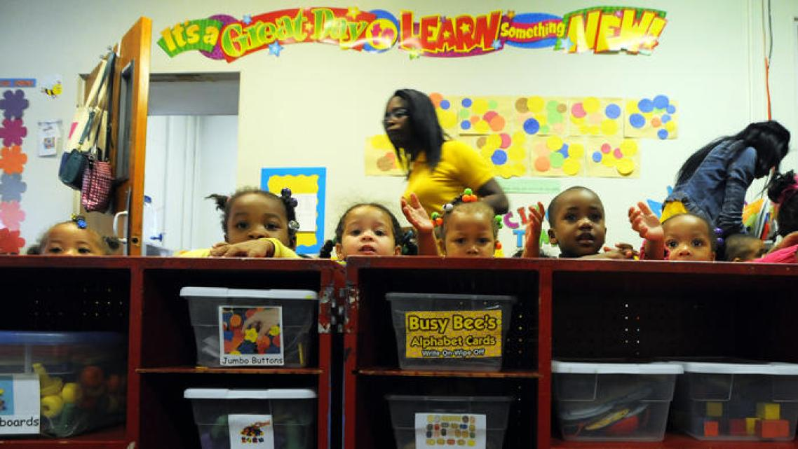 Lloyd Fox / Baltimore Sun Children wait for their next activity at Little Flowers Child Development Center. Located in the Upton/Druid Heights neighborhood, many of the children at Little Flowers are exposed to a variety of stressors, whether inside or outside the home, including violence.