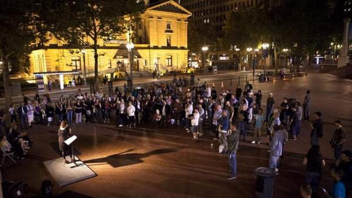Members of recovery programs, graduates and supporters listen as Patty Katz discusses her battle during an event celebrating recovery in Pioneer Courthouse Square in Portland, Ore. Alton Strupp/the Courier-Journal