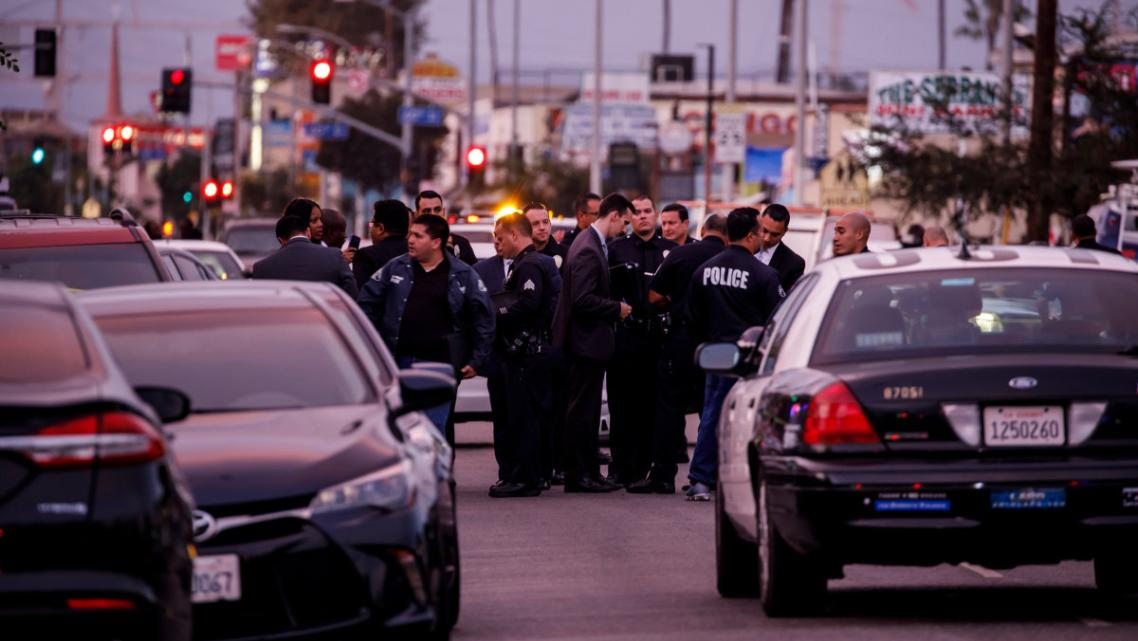 Police respond to a crime scene near Hawkins High School. (Marcus Yam / Los Angeles Times)