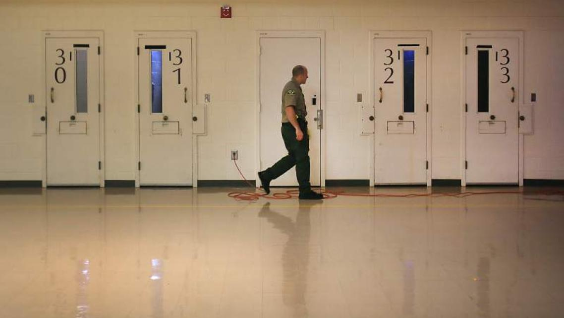 A Sonoma County sheriff corrections officer makes his rounds in the mental health wing at the Sonoma County Main Adult Detention
