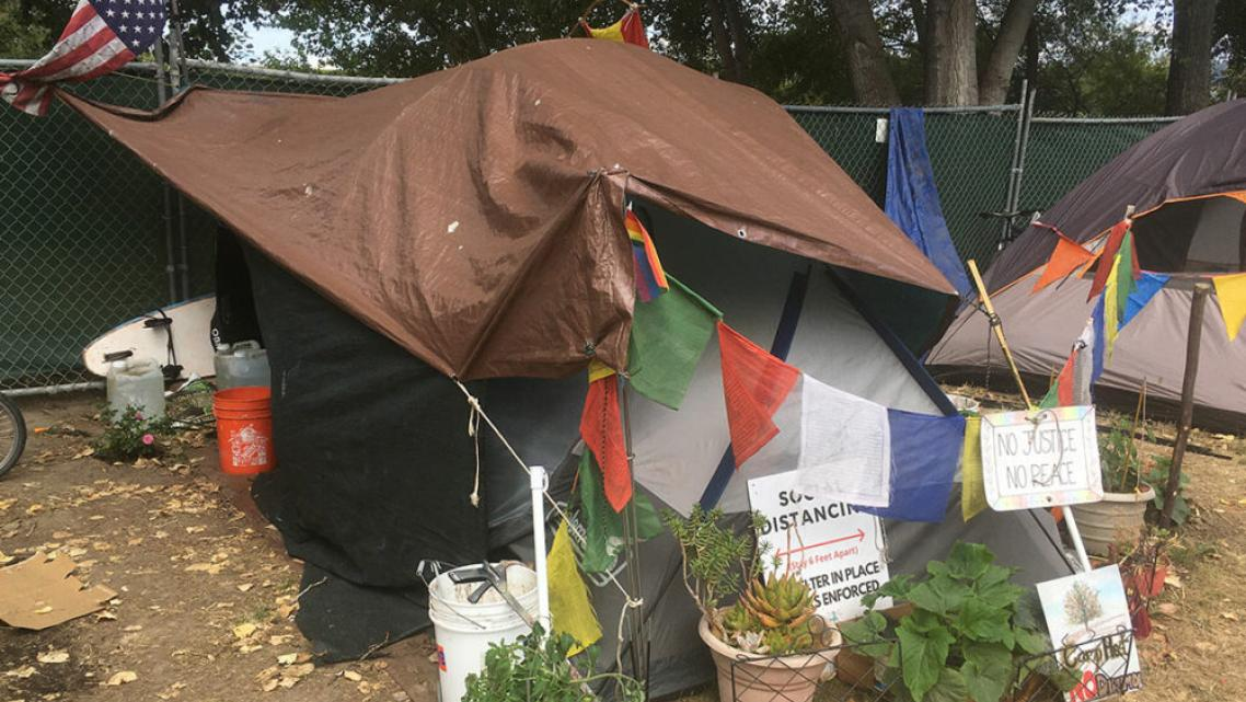 RESIDENTS OF A NEW MANAGED HOMELESS CAMP AT SAN LORENZO PARK HAVE ADDED THE TRAPPINGS OF HOME TO THEIR TENTS.
