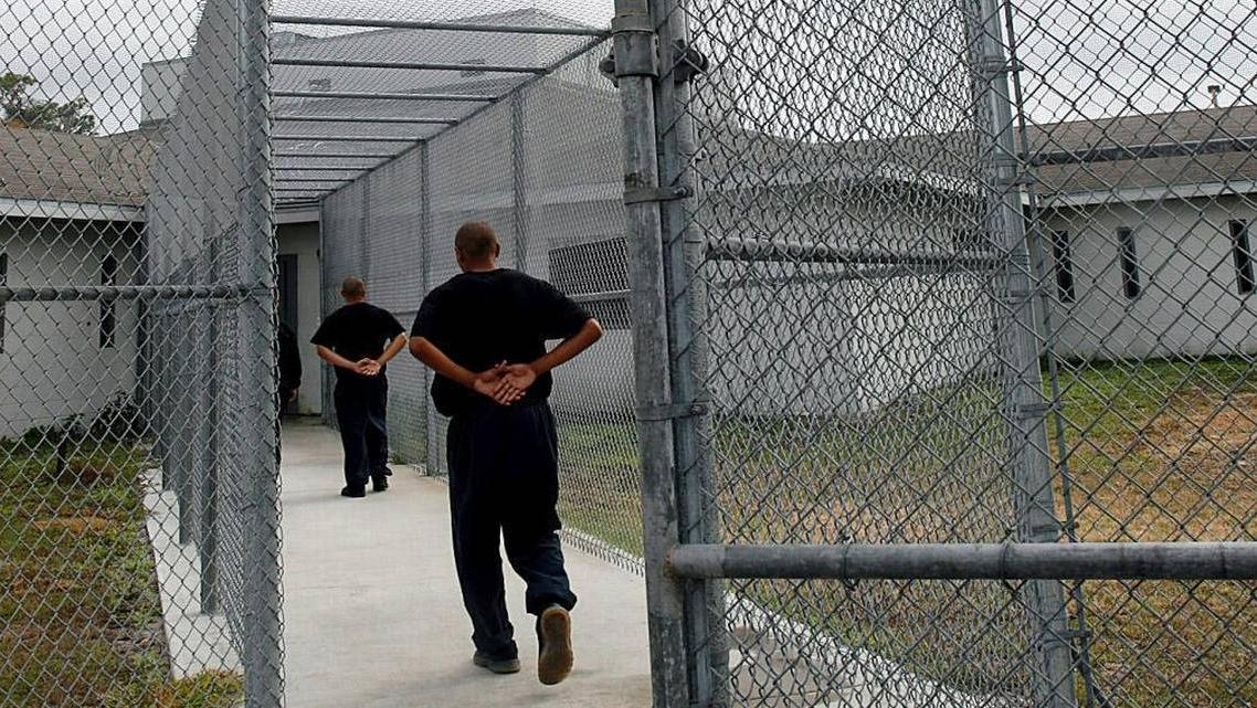Detainees return to the building after outside recreation time at Palmetto Youth Academy.