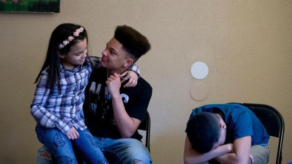 Jaden, left, Jenaya and James inside their Portland apartment.
