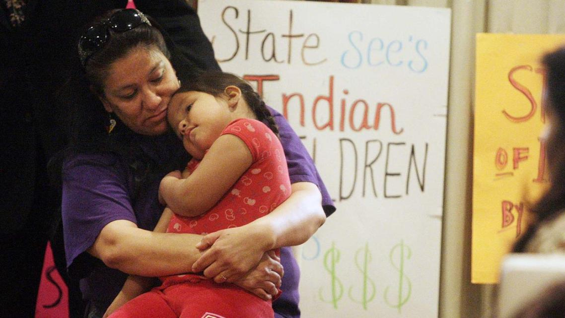 Madonna Pappan and her child in 2013. Pappan was is one of three Sioux mothers who sued South Dakota over its alleged violation