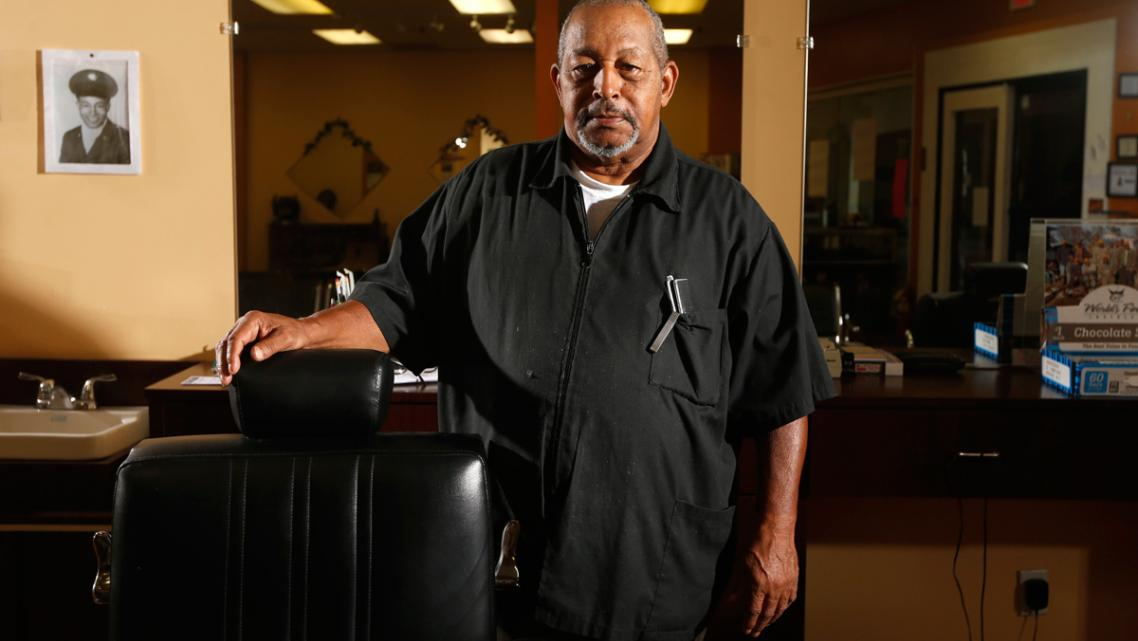 Walter Shearin talks with his customers about prostate cancer at his store, Walt's Diversity Barber Shop, in Roanoke Rapids.