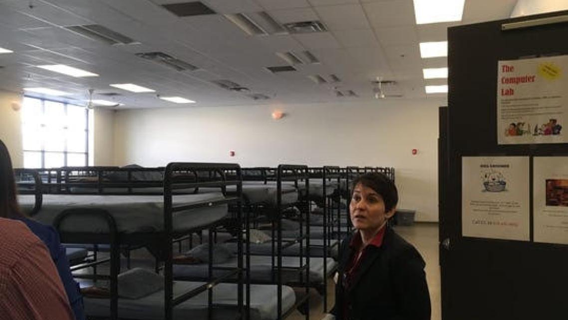 Amina Aun, shelter manager at Roy's Desert Resource Center, offers a tour of the shelter.