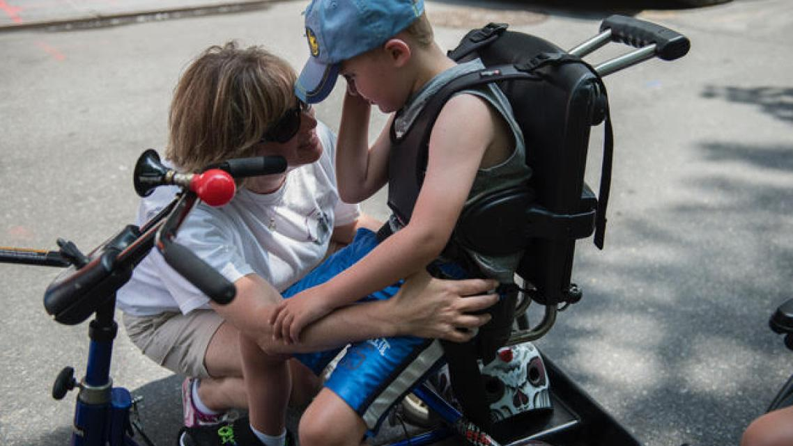 A mother comforts her son during the first annual Disability Pride Parade in 2015 in New York City.
