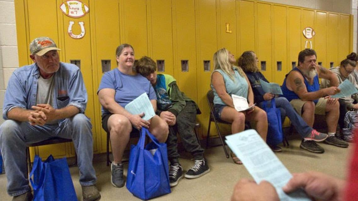 People wait for vision care at Lee County High School during a remote area medical clinic last year.