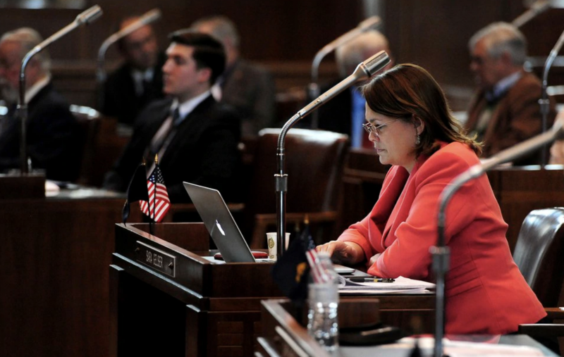 (Brent Drinkut | Statesman-Journal via AP) In this Feb. 2, 2015, photo, Sen. Sara Gelser, D-Corvallis, sits at her desk during the opening day of the Oregon legislative session at the Capitol in Salem, Ore.