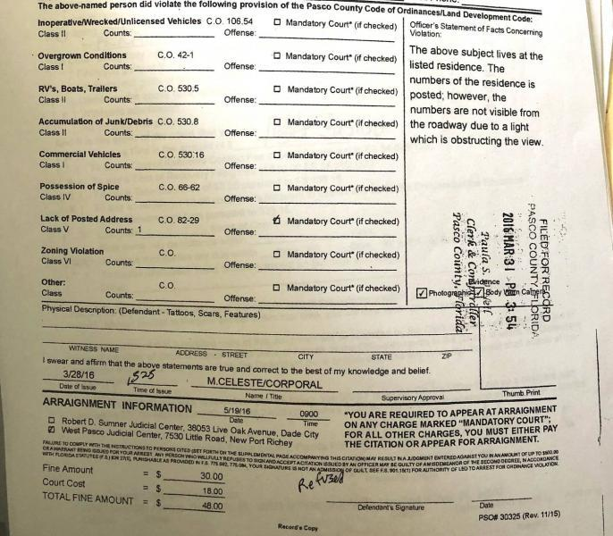 The father of one Sheriff's Office target was fined over the numbers posted on his house. The numbers were there, the document notes in the top-right, but a nearby light made them hard to see. The form indicates the father had to attend a mandatory court hearing. Pasco Sheriff's Office