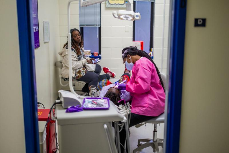 A Joe Louis Street single mom Kisha Simms spends an afternoon at home with her girls, and takes the younger one DeeDee, 11, to the dentist. ALICIA DEVINE/TALLAHASSEE DEMOCRA