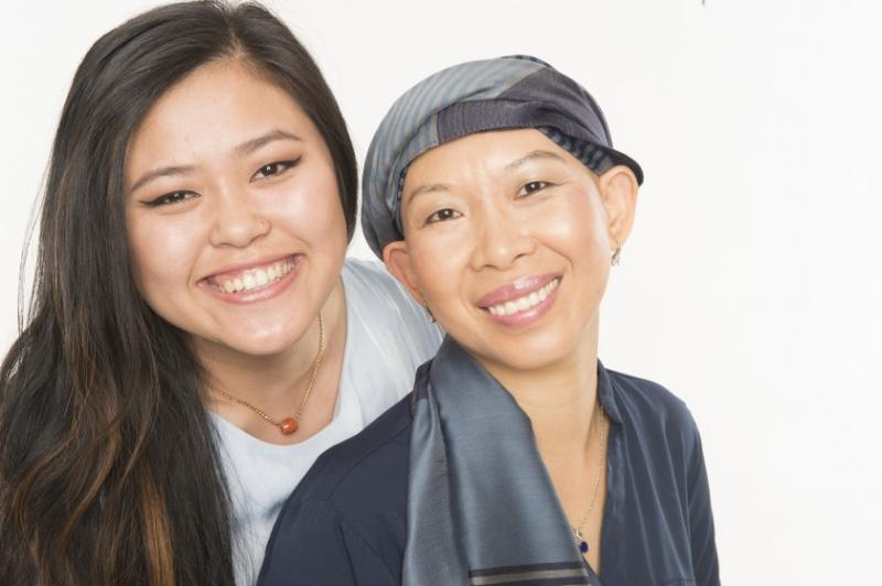 Angkearoth Leap, right, says that she relied heavily on the Cambodian Family's Cindy Sicheang Phou, who previously worked as a health navigator supported Leap through her breast cancer treatments.(Photo by Bong Roth)