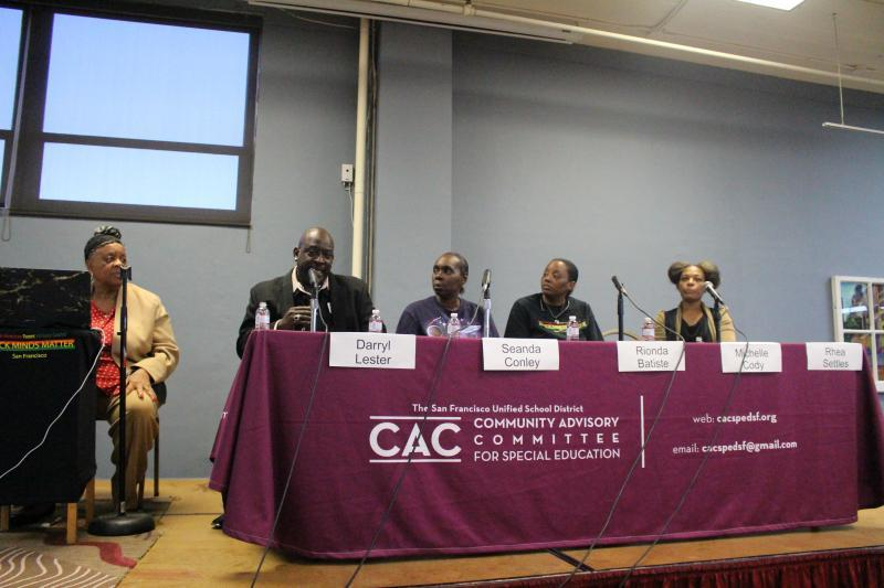 "Darryl Lester, second from left, speaks during the panel discussion about how his experiences in special education during the late 1960s affected him. Lester is ""Larry P.,"" the lead plaintiff in a seminal class-action lawsuits from the 1970s over the unjust  treatment of black students in special education. (Photo: Joe Goyos/Support for Families of Children With Disabilities)"
