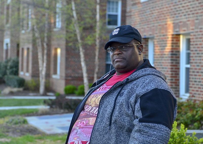 Leon Lightfoot, who has lived in Dahlgreen Courts Apartments with his family since 1999, stands in front of the building. Lightfoot said that his wife and son have asthma and that he has headaches and other respiratory problems. (Freddie Allen/AMG/NNPA)