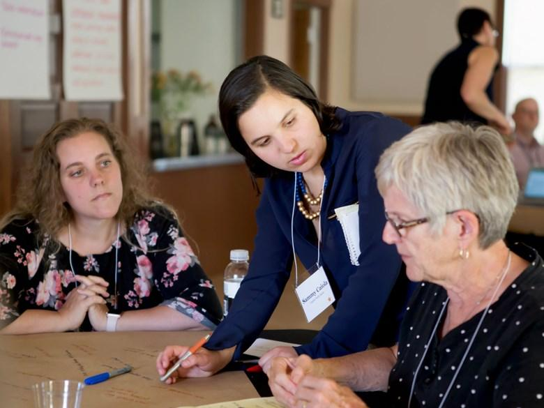 Capital Public Radio reporter Sammy Caiola takes notes at a June 2018 stakeholder convening in Sutter Creek, Calif. Photo: Vanessa Nelson.