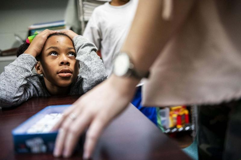 Laneyia Keating, left, gets words of encouragement from Leighanna Thompson of Louisville during Volunteers of America's Study Buddy program, Thursday, Jan. 24, 2019, at Transitional Housing Program & Emergency Family Shelter in Louisville, Ky.