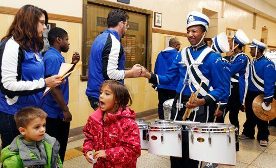"Paul Braun, co-director of the North Division High School Drumline (left) shakes Maleak Taylor's hand, before the start of the MPS Hosts City Drumline Competition at Rufus King High School. ""Most freshmen come in and they act like freshmen. You don't see that from Maleak. He's a real leader and we (the drum line) will go as he goes. He's the leader,"" said Braun. (Photo: Angela Peterson/Milwaukee Journal Sentinel)"