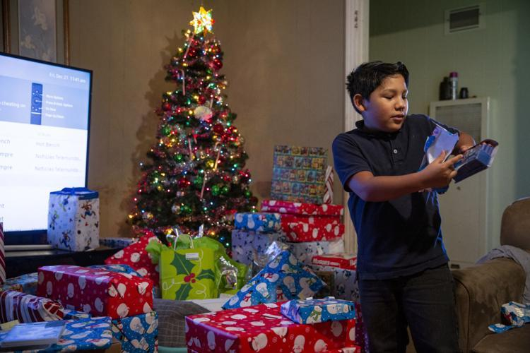 Fernando Martinez, 10, opens foam darts for a Nerf gun that was donated to him by Citizens Medical Center's Birth Center employees.