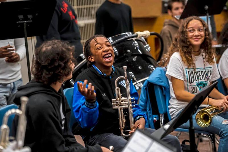 Ethan Zawacki of Chalfant, left, Jaden Weems of Rankin, center, and Sierra Smith of Swissvale, right, joke around before the start of band class at Woodland Hills Junior/Senior High School in Churchill.