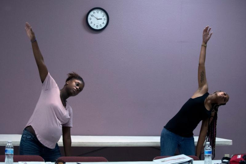 Dankia Williams, 30, left, and Jazmine Davis, 25, stretch after meditation during a Black Infant Health program held at Living Way Community Church in Moreno Valley on Wednesday, Oct. 17, 2018. Both live in Corona. (Photo by Cindy Yamanaka, The Press-Enterprise/SCNG)