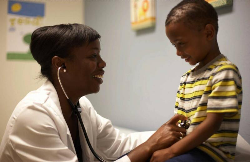 Dr. Nadine Burke Harris and a patient. (Courtesy Center for Youth Wellness)