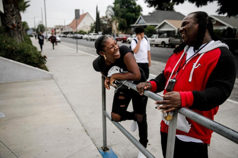 Jaleyah Collier, a senior at Hawkins High School, talks to Andre Vickers of Chapter Two, a local gang prevention program. (Marcus Yam / Los Angeles Times)