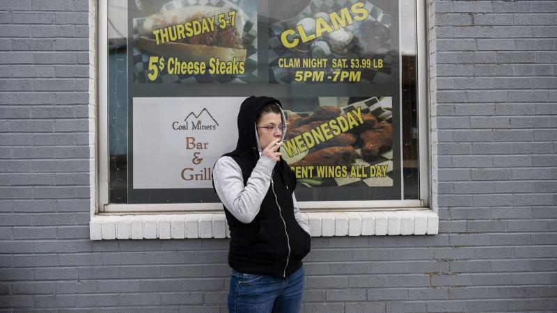 Alicia Kachmar of Lansford takes a puff from her cigarette outside of Coal Miners Bar & Grill in Lansford. Rick Kintzel / The Morning Call