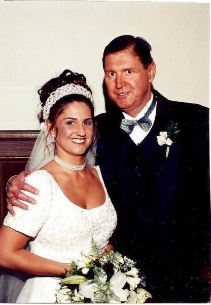 Cheryl Youngbloood's husband, Michael Youngblood, poses with their daughter, Amy, at her wedding in May 1999. He died before he could walk his baby girl, Stacie, down the aisle.