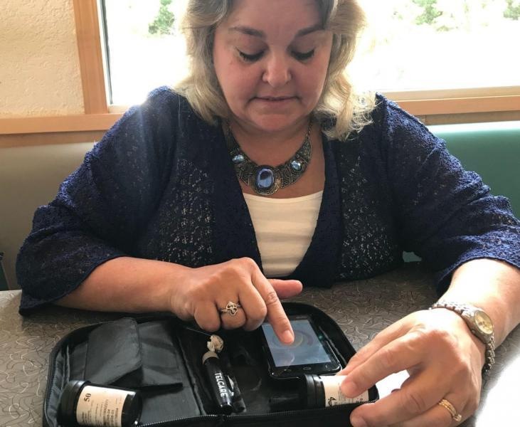 Betty Lowe of Hillsville shows how she uses a kit to control her diabetes that she received through the University of Virginia's telehealth program. Lowe said no matter what she did before enrolling in the program that links her electronically with a diabetes specialist, she could not get the disease under control. Now her readings are routinely in line and she no longer feels as though she has the flu. (LUANNE RIFE | The Roanoke Times)