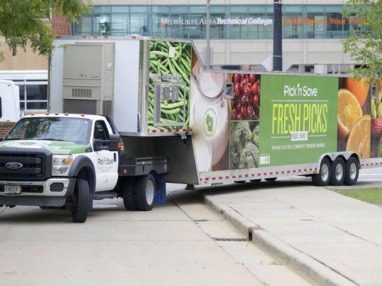 The Fresh Picks Mobile Market pulls up to the downtown Milwaukee Area Technical College campus. The mobile store visits neighborhoods lacking access to quality fresh grocery items. (Photo: Mike De Sisti, Milwaukee Journal Sentinel)
