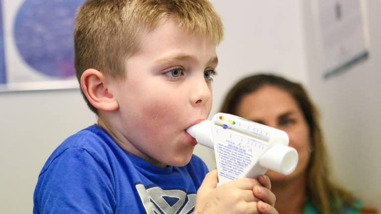 Gwynne Stump watches as her son Kagan tests his lung strength. He is being treated for asthma by Dr. William Morgan, a pediatrician in Arroyo Grande. The Nipomo family is concerned about particulate pollution in the area. David Middlecamp DMIDDLECAMP@THETRIBUNENEWS.COM