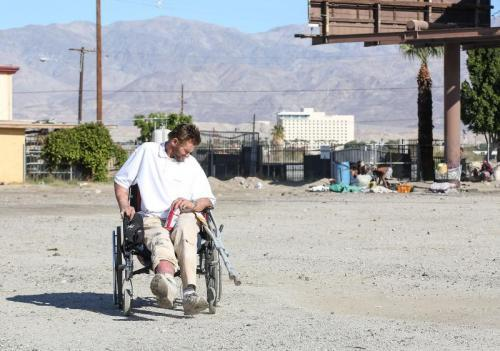 Robert Hensley pushes himself with one foot in his wheelchair. He was hit by a car three years ago. (Photo: Jay Calderon/The Desert Sun)
